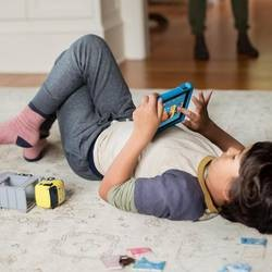 Undated handout photo issued by Amazon of a child using the new Amazon Fire HD Kids Edition, a tablet aimed specifically at children, with content that can be entirely controlled by parents. PRESS ASSOCIATION Photo. Issue date: Wednesday June 3, 2015. The tablet has gone on sale in the UK today starting at £119, and includes a two-year guarantee that means if anything happens to it, it can be traded in for free and replaced. See PA story TECHNOLOGY Amazon. Photo credit should read: Amazon/PA Wire NOTE TO EDITORS: This handout photo may only be used in for editorial reporting purposes for the contemporaneous illustration of events, things or the people in the image or facts mentioned in the caption. Reuse of the picture may require further permission from the copyright holder.